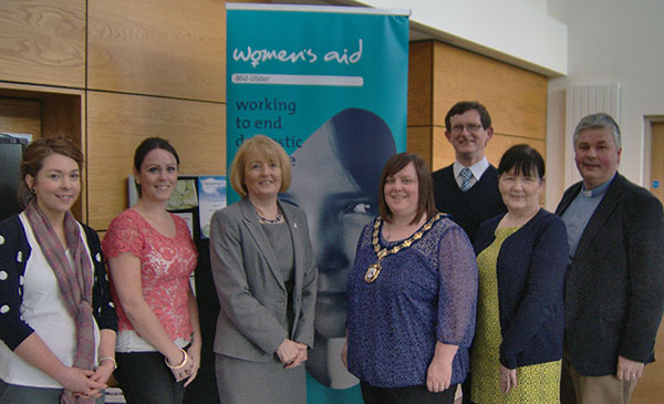 The Chair of Magherafelt District Council is pictured cutting the Ribbon to officially open Mid-Ulster Women's Aid Outreach Office in Maghera.